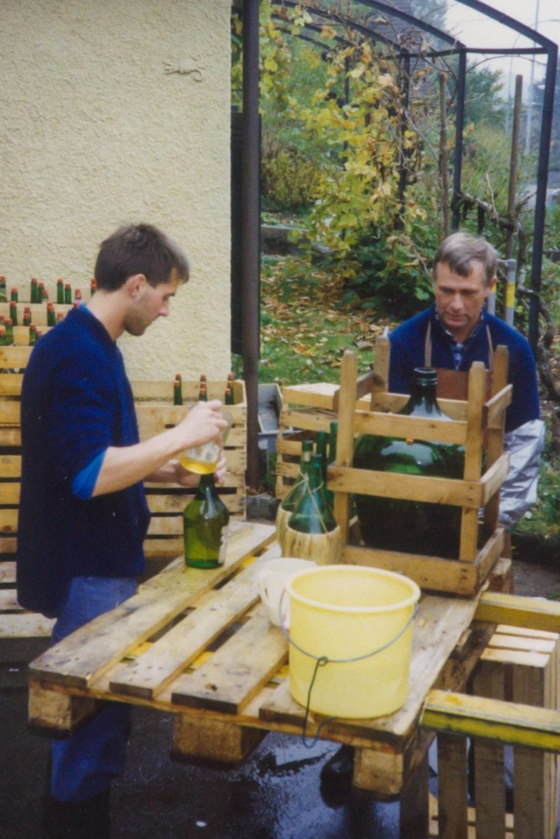 Martin Rellstab and his father, Heini, pasteurising apple juice (1990)
